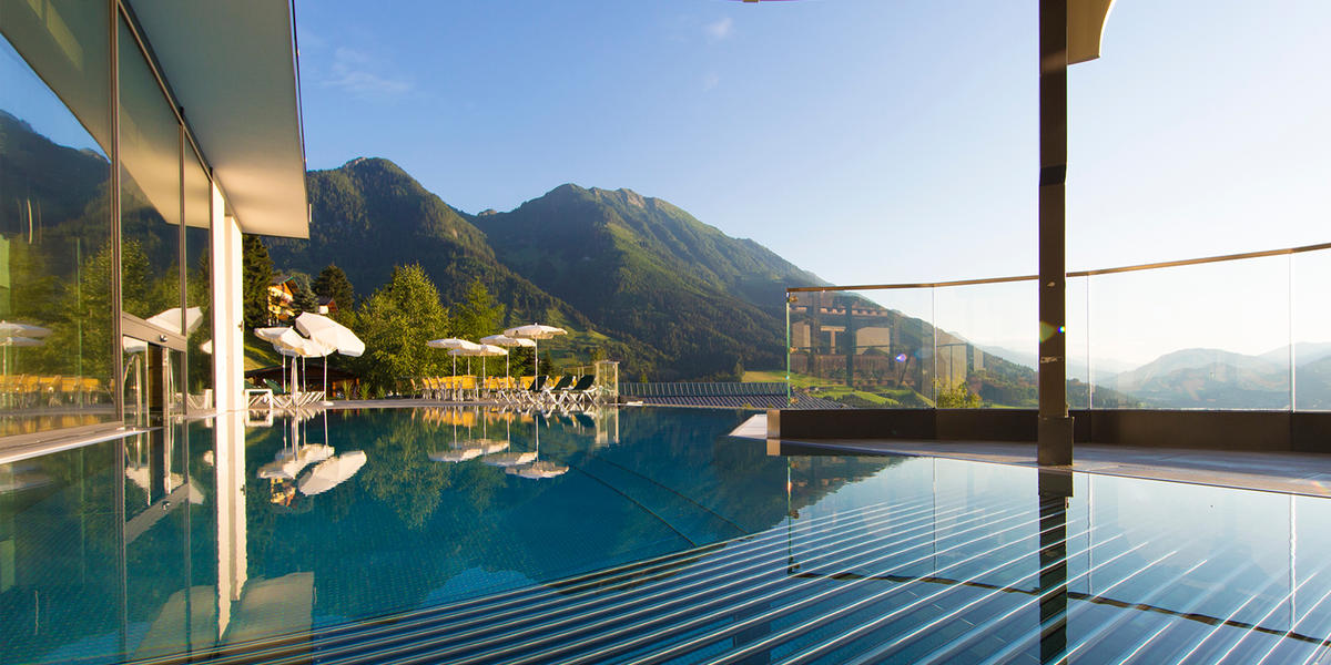Rooftop-Pool im Sommer, Alpina Family, Spa & Sporthotel in Alpendorf, Salzburger Land